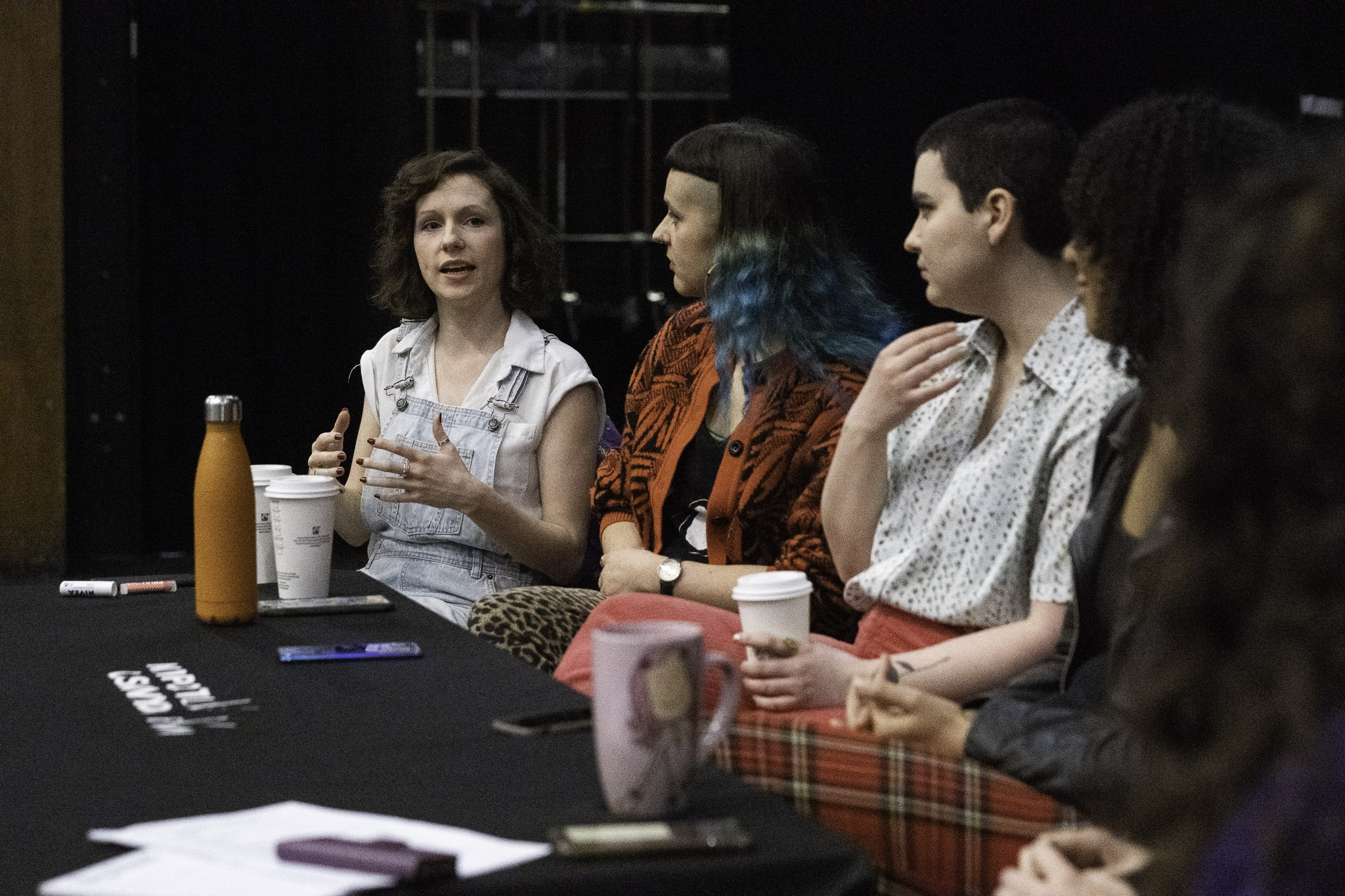 Group of female producers sitting around a table having a discussion